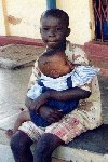 (Photograph of a young boy and a baby in Soroti)